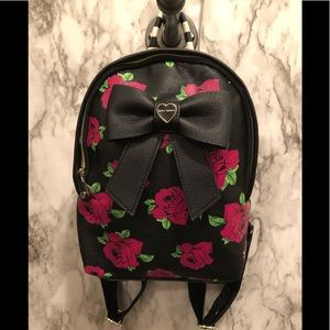 Betsy Johnson rose and striped backpack